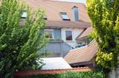 Raffinierte Dachgaube, Balkon und Loggia an einem Zweifamilienhaus in Sexau